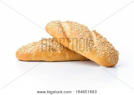 Loaves of white bread with sesame seeds over white background