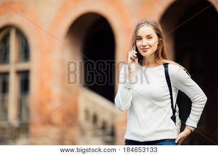 Happy Student Girl Speaking Mobile Outdoors Near University