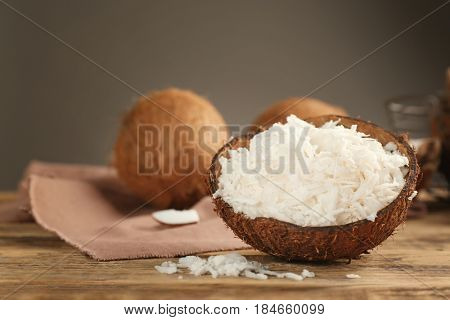 Grated coconut in shell on wooden table
