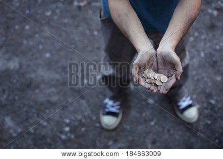 Poor man begging for money on the street