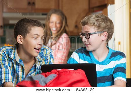 Cheerful Friends Doing Homework With Parent Watching