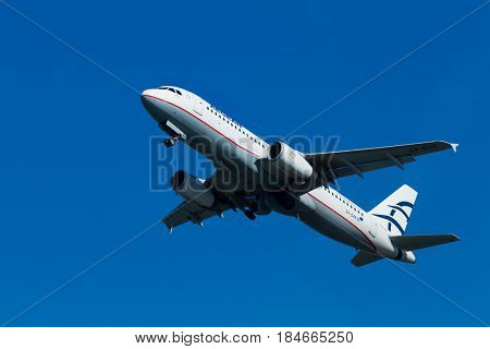 CORFU, GREECE - April 25: An Aegean Airbus charter taking off  in Corfu,Aegean is an airline from Greece with its headquarters in Athens
