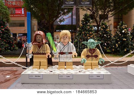 HONG KONG - CIRCA DECEMBER, 2015: life-sized Lego figures of Obi-Wan, Luke Skywalker, Yoda at the Force Awakens exhibition in Times Square