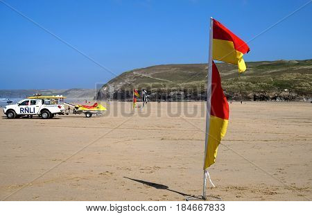 Newquay, Cornwall, Uk - August 7 2017: Warning Flags On The Beach For Swimmers And Surfers, With Rnl