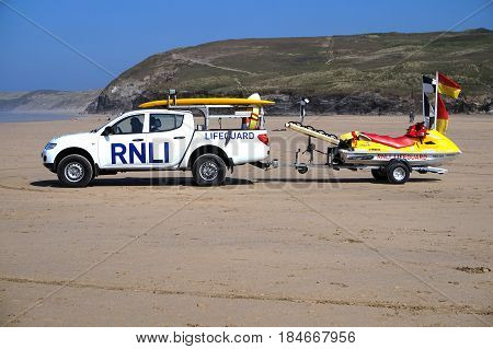 Newquay, Cornwall, Uk - August 7 2017: Rnli Lifeguard Truck And Jet Ski On A Cornish Surfing Beach A