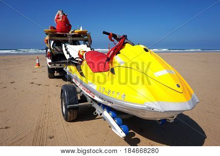 Newquay, Cornwall, Uk - August 7 2017: Rnli Rescue Jet Ski Behind A Truck On A Surfing Beach In Newq
