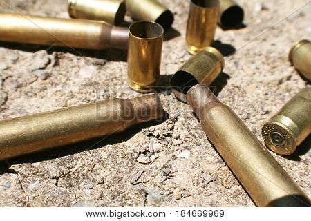 Bullet Casings On Desert Ground During War High Quality