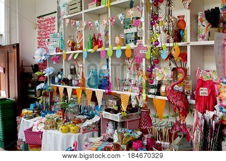 St Ives, Cornwall, Uk - April 3 2017: Colourful Homeware Items For Sale On Shelves In A Fancy Goods