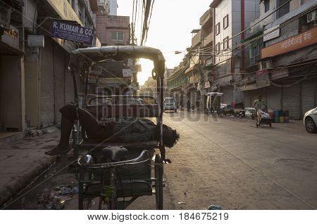 DELHI INDIA - JUN 10 : driver sleep in his rickshaw in morning at Chawri Bazar. Chawri Bazar is hardware market in Old Delhi area of Delhi on june 10 2015 india