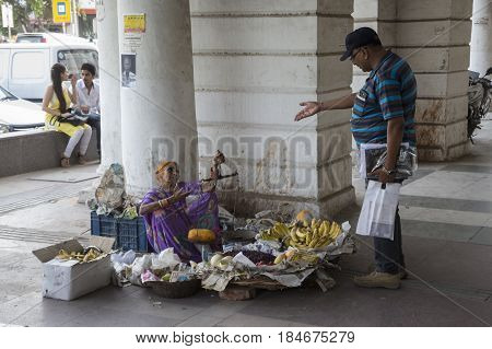 DELHI INDIA-JUN 10 : floor fruit stall in Connaught Place. this place is large shopping place in central delhi of Delhi on june 10 2015 india