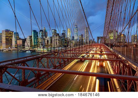 View of Brooklyn Bridge at night with car traffic Brooklyn Bridge at night