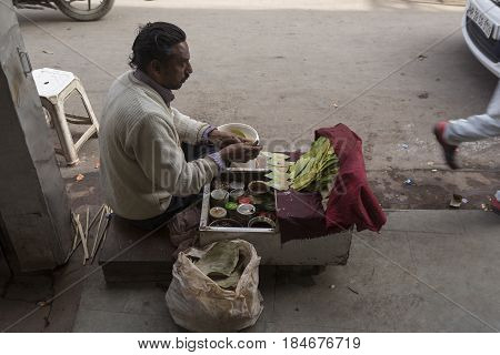 DELHI INDIA - DEC 20 : stall selling paan or betel leaf and betel nut as mouth freshener at spice market in old delhi of Delhi on december 20 2014 india.