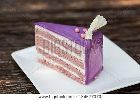 Taro Cake layer of cake and cream cover with purple sugar.
