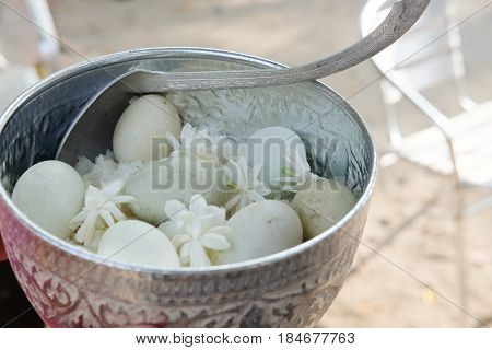 Cooking rice and boiled duck egg for give alms to a Buddhist monk Thailand traditional