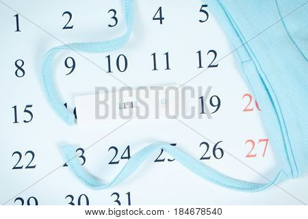 Vintage Photo, Pregnancy Test With Positive Result And Cap For Newborn On Calendar, Expecting For Ba