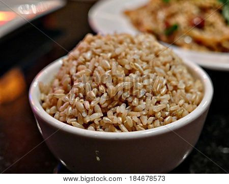 Cooked brown rice A bowl of long grained, steamed brown rice
