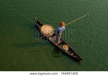 Unidentified People Fish In A Lake In Amarapura, Myanmar. Amarapura Is Famed For The Longest Teak Br