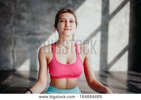 Woman Practicing Yoga In Lotus Pose Indoor. Fit Girl In Sportswear Sitting In Padmasana