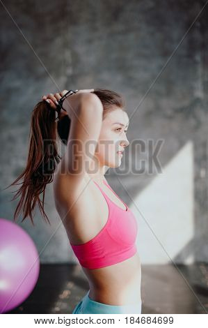 Womans Break In Workout To Tie Her Hair.