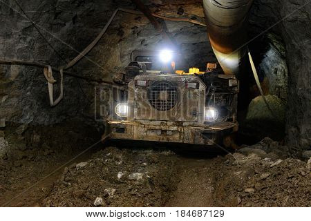 Mining industry. Photo of metal ore mechanical transportation
