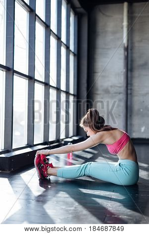 Fitness, Sport, Training, Gym And Lifestyle Concept - Smiling Teenage Girl Stretching In The Gym.