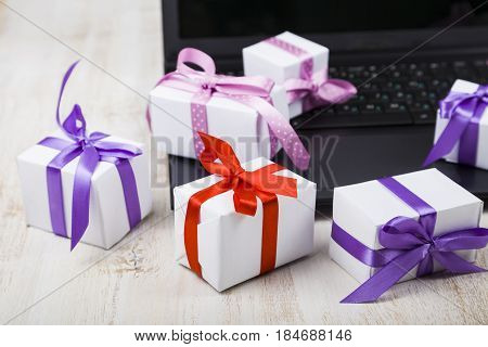 Many Gift Boxes On A Laptop.