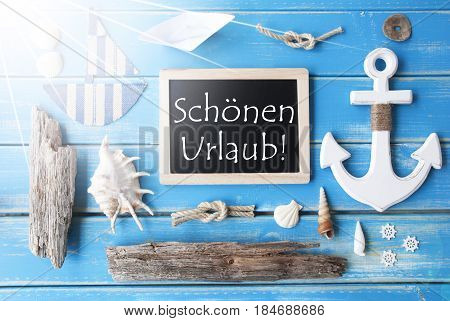 Flat Lay Of Chalkboard On Blue Wooden Background. Sunny Nautic Or Maritime Summer Decoration As Holiday Greeting Card. German Text Schoenen Urlaub Means Happy Holidays