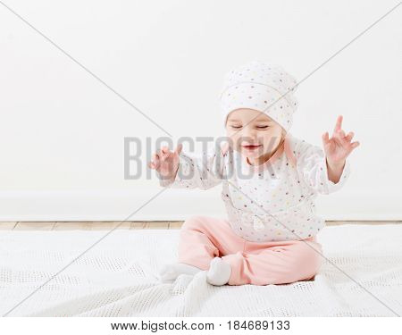 the beauttiful happy little girl on floor