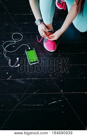 Runner Woman Tying Running Shoes Laces Getting Ready For Race On Run Track