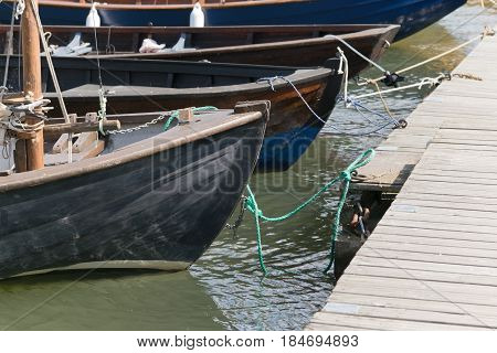 Close up of boats docked at pier at the see port in Finland.