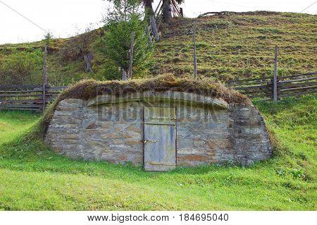 Door of antique rural cellar barn Ukraine