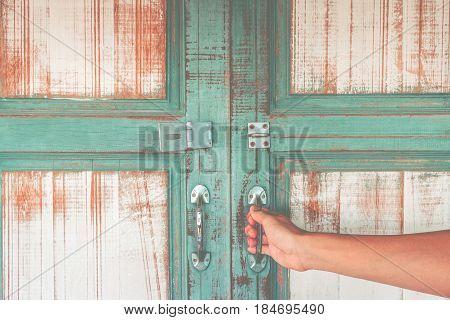 Asian Hand Holding A Metal Door Handle For Open The Ancient Wooden Slide Door. Open The Ancient Door
