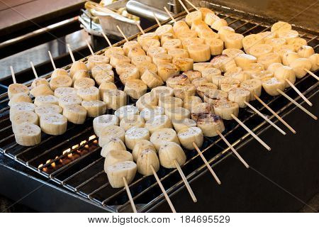 Roasted Banana Or Grilled Banana Skewer In Asian Traditional Style. Thai Banana Sweet Dessert.