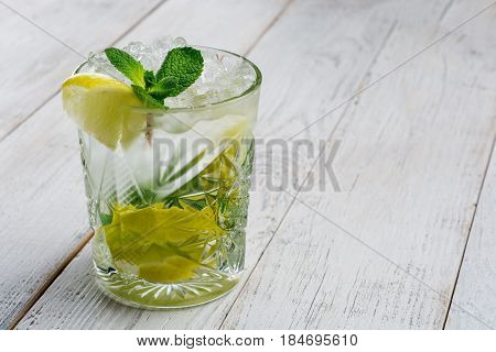 Tradition Summer drink mojito with lime and mint. Top view with copy space .
