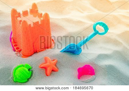 Plastic Beach Toys On The Beach With Sand And Copy Space For Background. Close Up Of Children's Beac