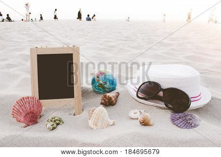 Straw Hat, Sun Glasses, World Ball Toy, Seashell And Blank Blackboard For Text On Clean Sand Beach W