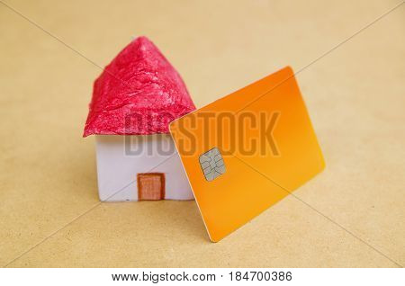 A small and beautiful house model concept, investment housing credit card.