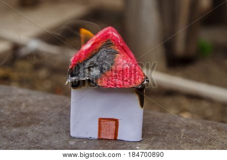 Small and beautiful house made of paper burning, house model concept.