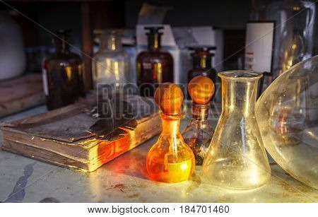 The old lab. The table of the alchemist. Laboratory table, stained with chemicals and poisons.