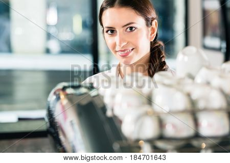 Portrait of confident young woman working in a commercial kitchen