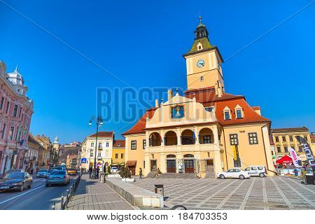 Brasov, Romania - March 24, 2015: The Council Square Piata Sfatului in downtown of Brasov, Transylvania, Romania and people
