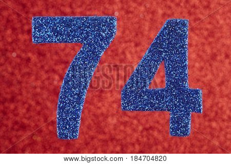 Number seventy-four blue color over a red background. Anniversary. Horizontal