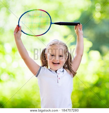 Child Playing Badminton Or Tennis Outdoor In Summer