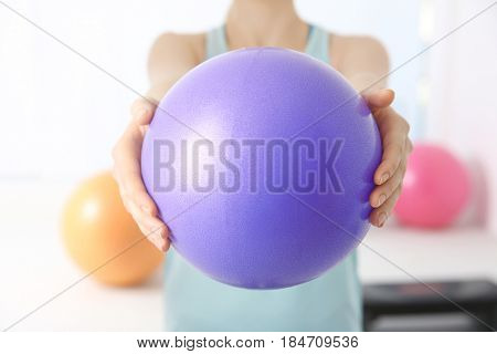 Woman with rubber ball in clinic, closeup