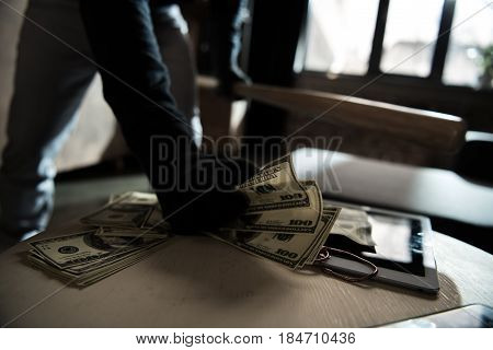 Robber Stealing Money