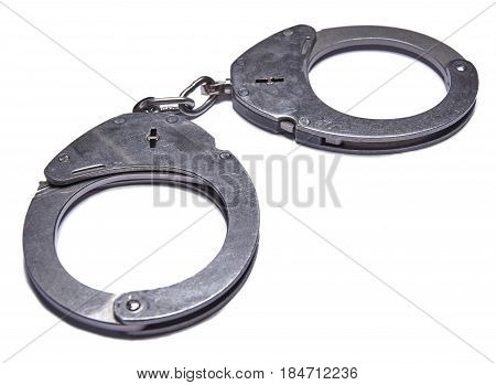 German police handcuff isolated on white background.