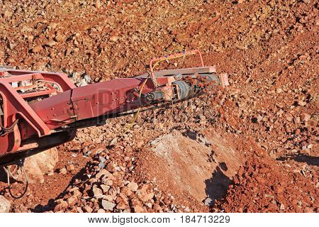 stone crusher working on a construction site