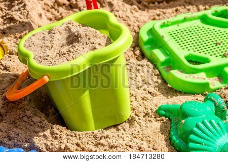 pail sieve and molds in the sand in the sandbox children playground