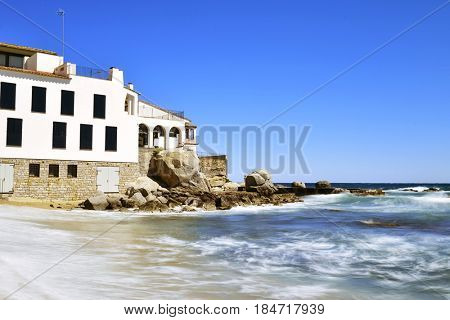a view of the Malaspina Beach in Calella de Palafrugell, Costa Brava, Catalonia, Spain, with its characteristics white houses