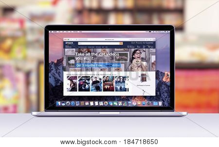 Varna Bulgaria - March 10 2016: Amazon web page in Safari browser on the Apple 15 inch MacBook Pro Retina screen. Blurred shopping center on the background.